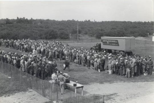 German POW's get assigned jobs at Vartins Cherry Orchard in Door County during World War II.