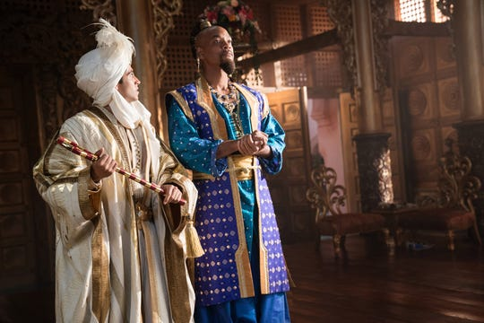 "Aladdin (Mena Massoud, left) needs advice on how to act princely from Genie (Will Smith) in the new ""Aladdin."""