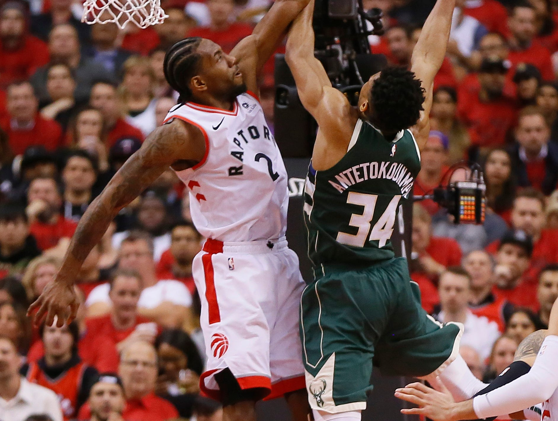 May 21: Milwaukee Bucks forward Giannis Antetokounmpo shoots the ball as Toronto Raptors forward Kawhi Leonard defends during the first half of Game 4.