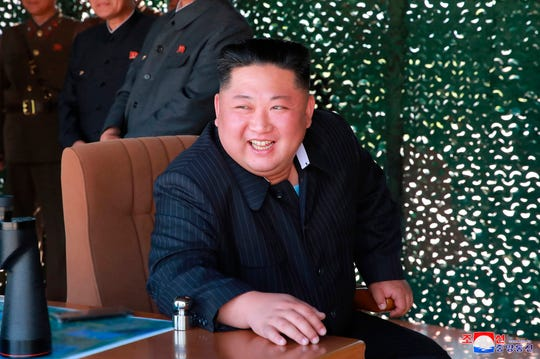 "This May 9, 2019, file photo provided on May 10, by the North Korean government shows North Korean leader Kim Jong Un, observing a military test in North Korea. North Korea has labeled Joe Biden a ""fool of low IQ"" and an ""imbecile bereft of elementary quality as a human being"" after the Democratic presidential hopeful during a recent speech called North Korean leader Kim Jong Un a tyrant."