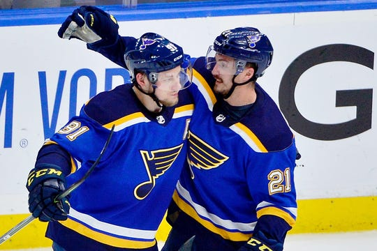 Blues right wing Vladimir Tarasenko, left, is congratulated by center Tyler Bozak after his first-period goal.