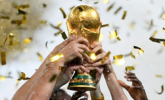 France's players lift the World Cup trophy after winning the 2018 World Cup in Russia.