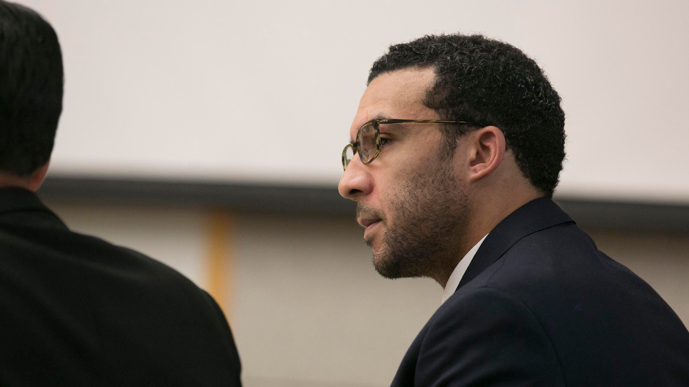 Kellen Winslow II looks at attorney Marc Carlos during his rape trial.