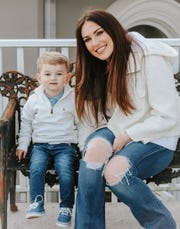 Jenna King-Shepherd poses for a photo with her son Barron. She is fighting for legal abortion access in her home state of Alabama.