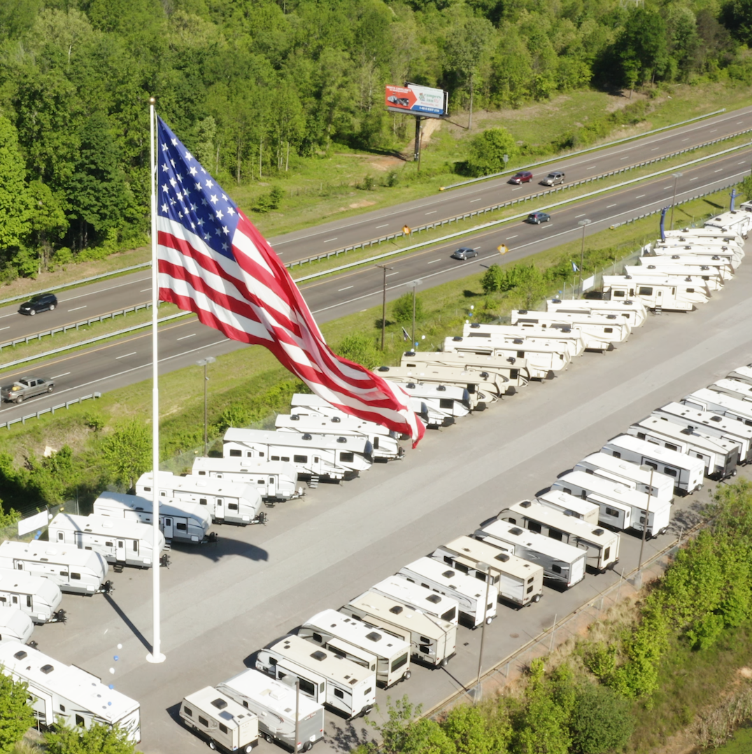 A city is suing an RV retailer over its 'gigantic' American flag. They won't take it down