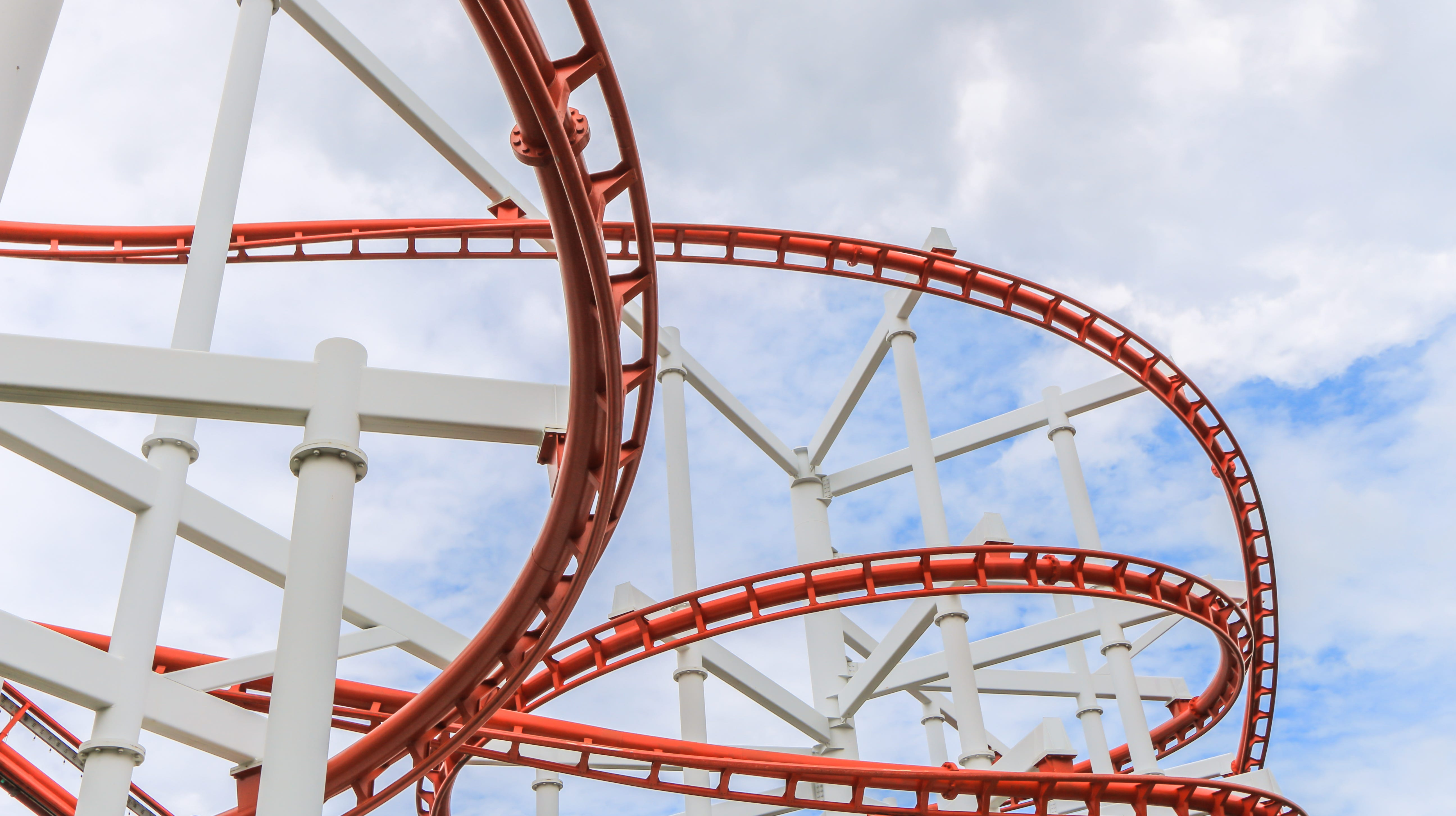 Red roller Coaster Track in amusement park.