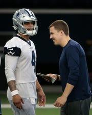Cowboys quarterback Dak Prescott listens to offensive coordinator Kellen Moore during practice Wednesday.