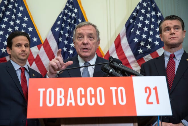 U.S. Sen. Brian Schatz, D-Hawaii, U.S. Sen. Dick Durbin, D-Ill., and U.S. Sen. Todd Young, R-Ind., join together to call for the Senate to raise the minimum age to purchase tobacco products to 21 during a news conference at the Capitol on May 8, 2019.