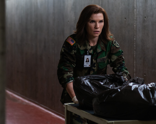 "Dr. Nancy Jaax (Julianna Margulies) stealthily transports infected monkeys in ""The Hot Zone."""