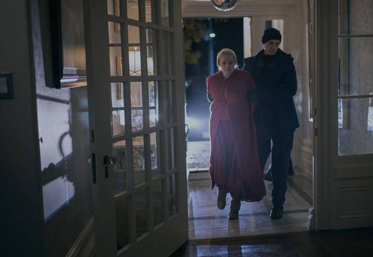 """In this exclusive photo from Season 3 of """"The Handmaid's Tale,"""" June (Elisabeth Moss) is back in Gilead's clutches after choosing not to escape to Canada last season."""