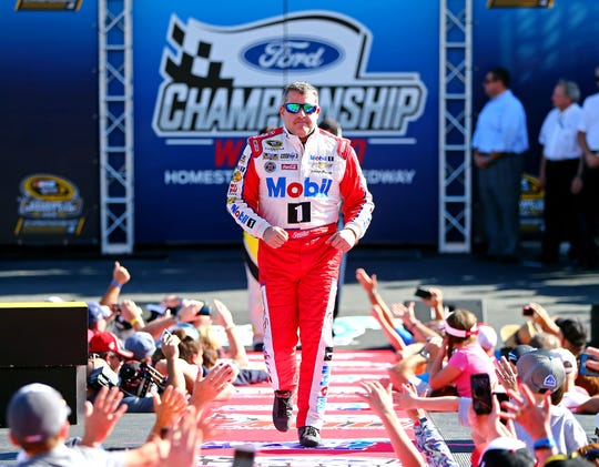 Tony Stewart (14) is introduced before before his final NASCAR Cup Series race -- the 2016 season finale at Homestead-Miami Speedway.