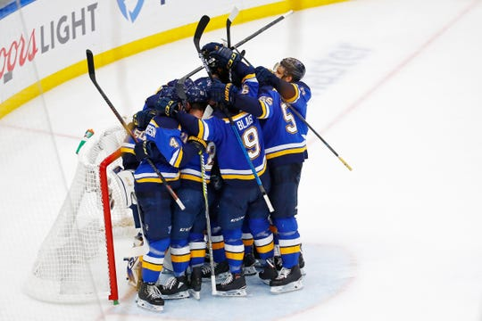 The Blues celebrate advancing to the Stanley Cup after beating the Sharks.