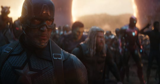 "Captain America (Chris Evans, left) leads a legion of superheroes in ""Avengers: Endgame."""