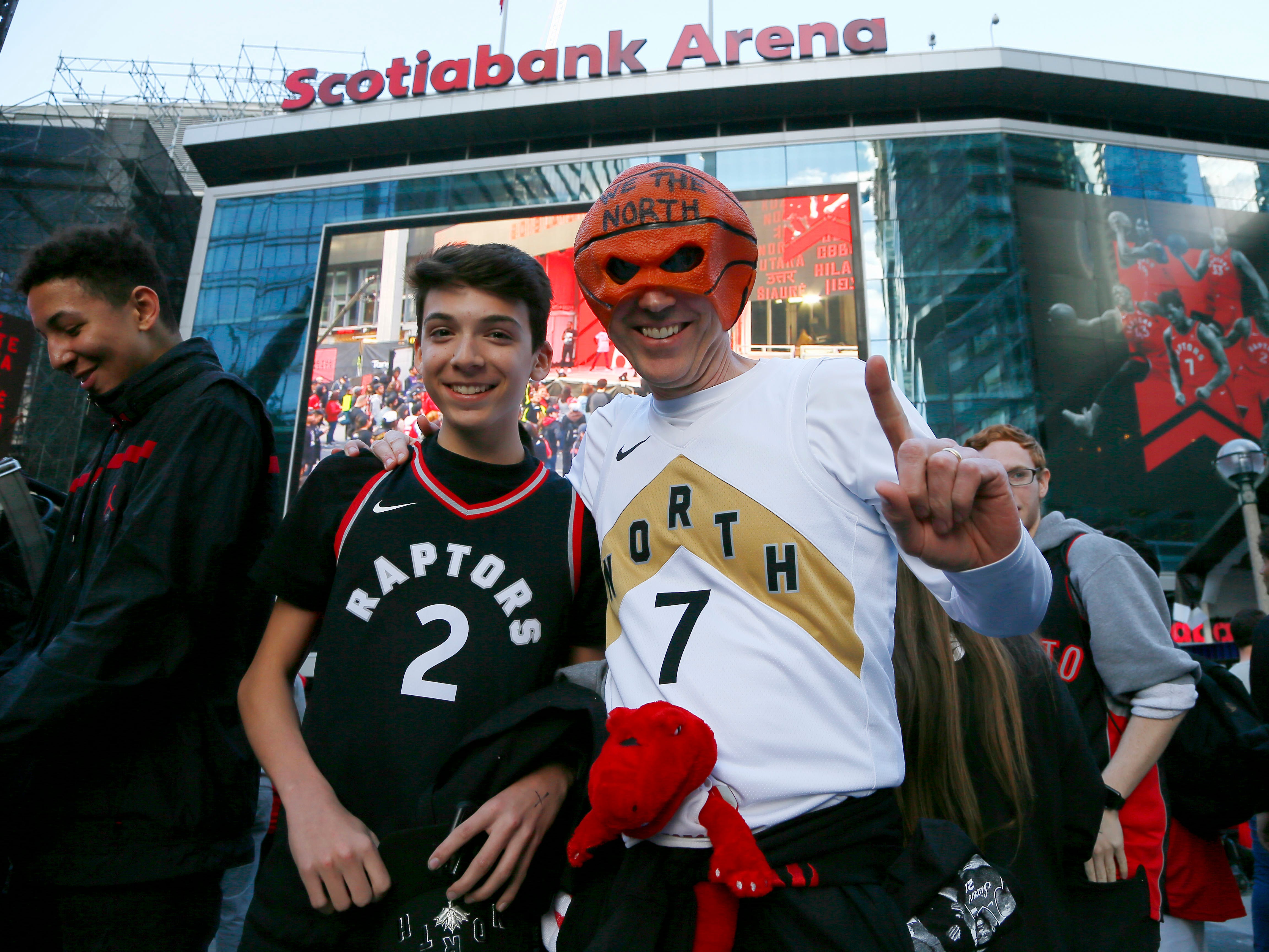 May 21: Toronto Raptors fans pose for a photo outside of Scotiabank Arena prior to Game 4 of the Eastern Conference finals.