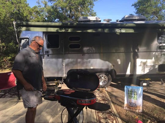 Jim Hogg, pictured outside his Eddie Bauer Edition Airstream, stopped to BBQ during a road trip from Tennessee to Texas.