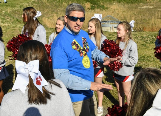 Superintendent Richard Rosenberger talks with Belton-Honea Path High School cheerleaders during the Special Olympics South Carolina Area 14 Spring Games.