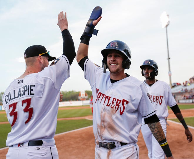 Brice Turang, center, could be one of the Brewers prospects sent to Appleton to further his development with the pool of players eligible for the major-league season. He played there last year with the Wisconsin Timber Rattlers.
