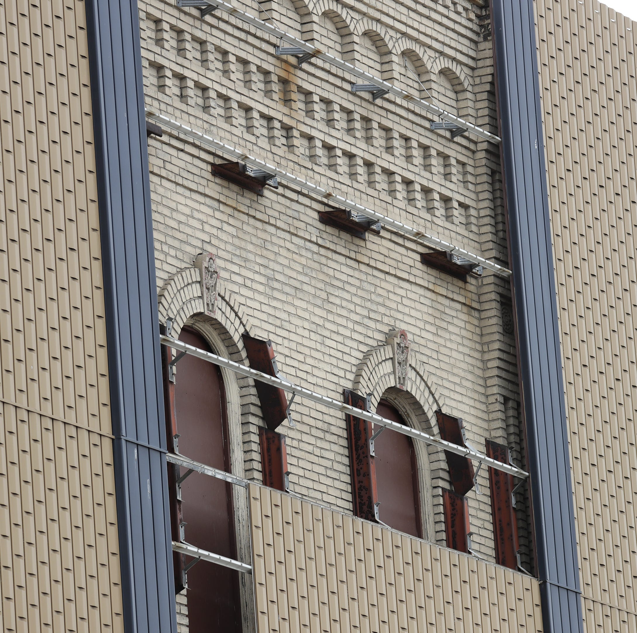 Gabriel Furniture building's facade is coming down, revealing historic detailed brickwork
