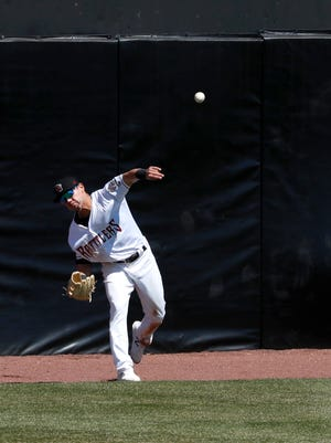 Timber Rattlers outfielder Jesus Lujano throws to the infield during a game against the Cedar Rapids Kernels last month at Neuroscience Group Field at Fox Cites Stadium.