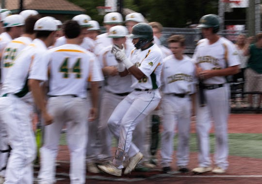 Red Bank Catholic's David Glancy is greeted by his teammates after his home run in the bottom of the first gave the Cases a 1-0 lead over Jackson Memorial in a Shore Conference Tournament quarterfinal. Red Bank Catholic won 3-0.