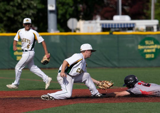 Red Bank Catholic shortstop Sean Ettore puts the tag on Jackson Memorial's Ryan Lasko as Lasko tries to steals second for the final out of the top of the fifth inning.
