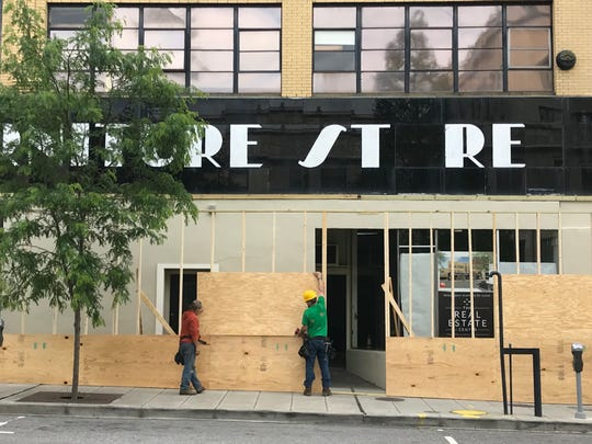 The street level of the former Pearlman's Super Furniture Store on Page Avenue in downtown Asheville will be renovated this year to accommodate retail shops. Pearlman's closed in the 1990s, but the upper part of the building is occupied by Kimmel & Associates. The iconic sign will remain.
