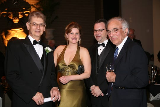 From left: Ron Siwiec, Catherine Sickora, Brian Sickora and George Akel at Tasting Opera, a fundraising event for the Tri-Cities Opera held April 12, 2008 at The McKinley in Endicott.