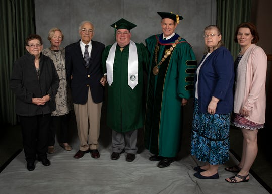 Franklin J. Frear (center) worked for Giant Markets in the mid-'80s while in high school. Akel (pictured left of Frear) attended Frears graduation along with Frear's family in May of 2018.