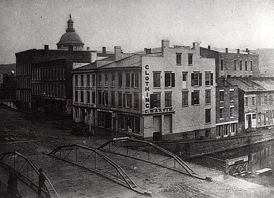The Chenango Canal passes under the Iron Bridge on Court Street in Binghamton, about 1860.