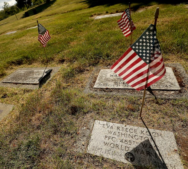 Small flags wave in the breeze marking the graves of veterans at Forest Lawn Cemetery in Bremerton on Wednesday, May 22, 2019.
