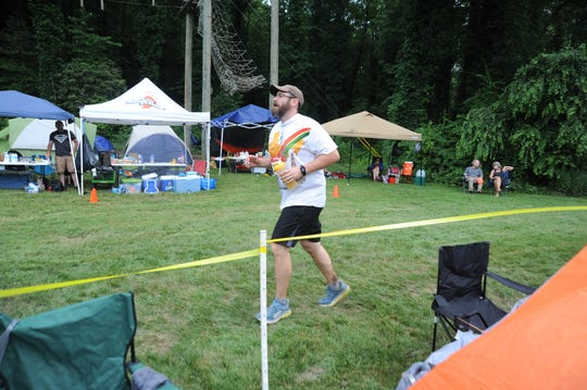 "A Black Mountain Monster runner passes through the ""tent city"" along the 3.125-mile course."