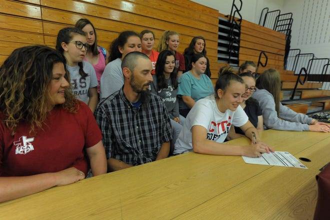 Surrounded by family, teammates and coaches, Owen senior Destiny Karber signs to play softball for the Red Hawks of Catawba Valley Community College on May 21.
