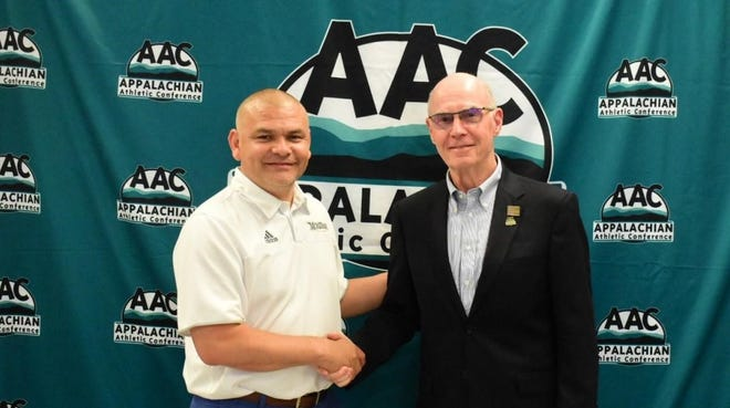 Montreat College athletic director Jose Larios, left, was named the Athletics Director of the Year in the Appalachian Athletic Conference for 2018-19.