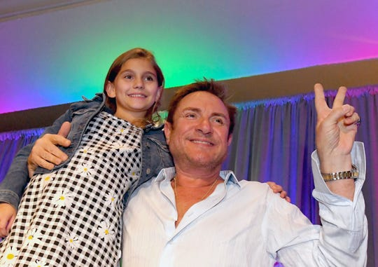 Her name was Rio: Simon Le Bon, lead singer of Duran Duran, meets 9-year-old Rio Ricardo, who was named for the song and album, during the Brevard Cultural Alliance 2019 Cultural Summit.