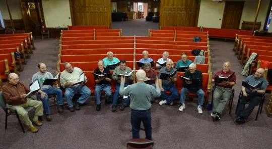 George Gibbs conducts members of United in Harmony during a rehearsal Monday evening at Bucyrus United Methodist Church.