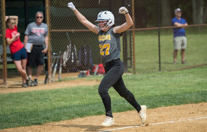 Moorestown's Julianna LaRusso celebrates after hitting a grand slam in the third inning of the softball sectional semifinal playoff game between Moorestown and Ocean City, played at Moorestown High School on Thursday, May 23, 2019.    Moorestown defeated Ocean City, 4-2.