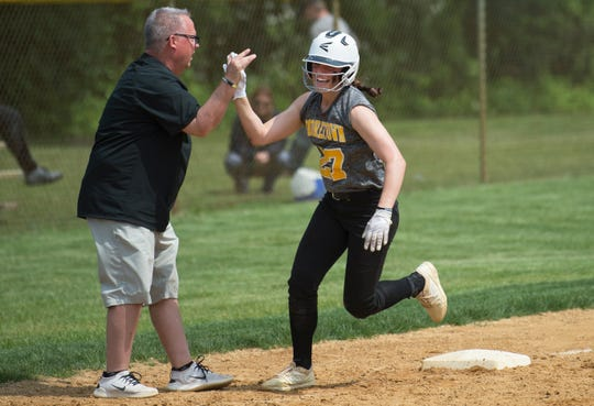 Moorestown's Julianna LaRusso celebrates with Moorestown High School's softball coach Bill Mulvihill after LaRusso hit a grand slam in the third inning of the softball sectional semifinal playoff game between Moorestown and Ocean City, played at Moorestown High School on Thursday, May 23, 2019.    Moorestown defeated Ocean City, 4-2.