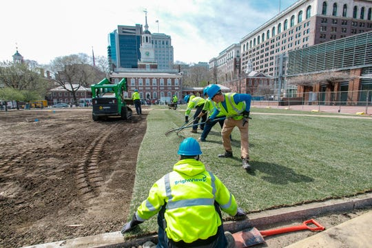BrightView Landscape Services workers renovate the open-air National Park Service mall in front of Independence Hall in Philadelphia as a company donated project before the reopening last week. They are installing sod grown at Tuckahoe Turf Farms in Hammonton