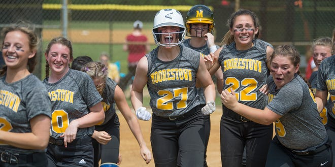 Moorestown's Julianna LaRusso, center, celebrates with teammates after LaRusso hit a grand slam in the third inning of the softball sectional semifinal playoff game between Moorestown and Ocean City, played at Moorestown High School on Thursday, May 23, 2019.    Moorestown defeated Ocean City, 4-2.