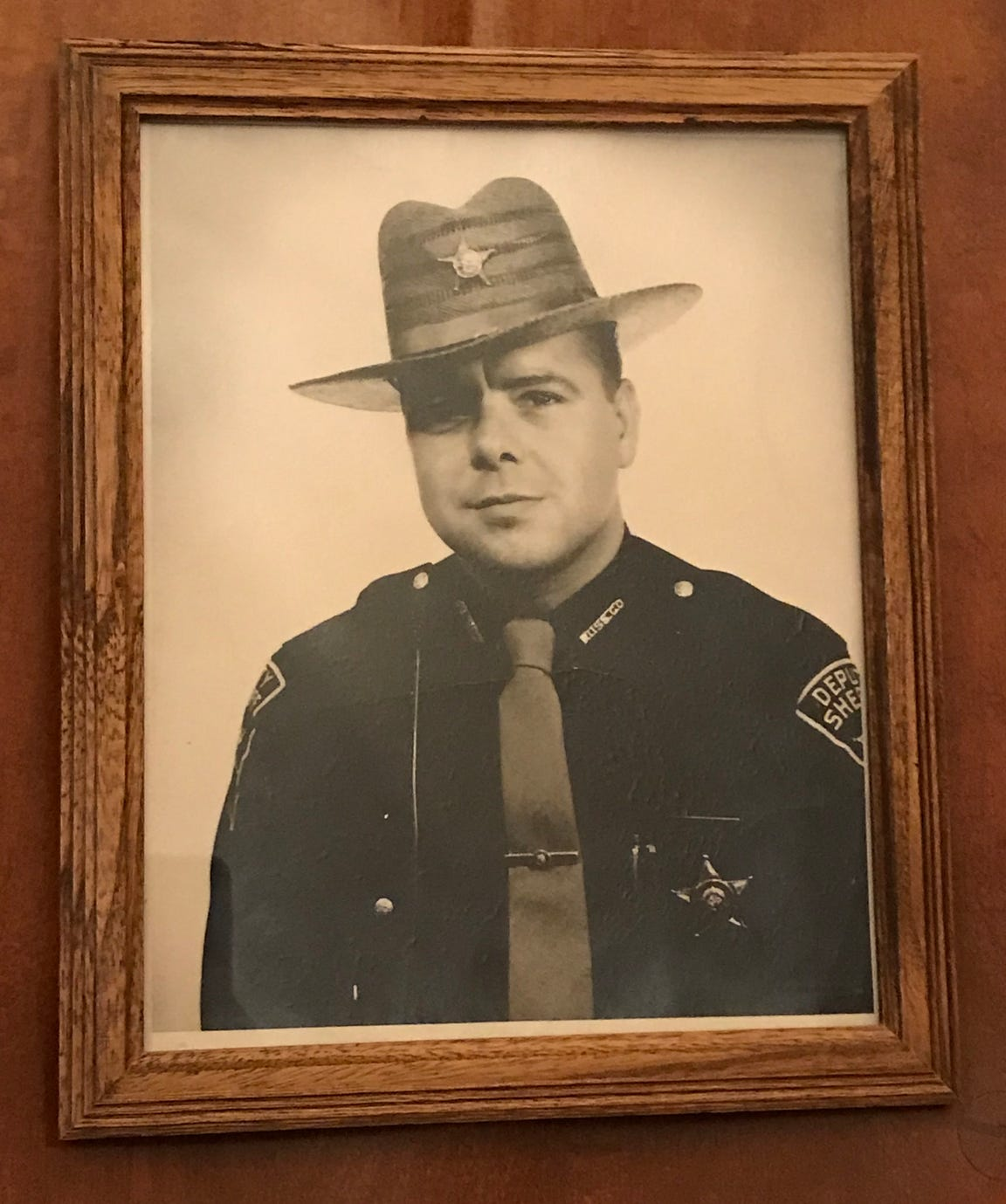 A framed black and white photo of Doug Ray in his Ross County sheriff's uniform in the 1960s is among several photos capturing moments of his and his family's lives on display throughout his and his wife Phyllis Ray's home. Ray joined the Ross County Sheriff's Department in 1959 and has maintained his commission and certification now for 60 years.