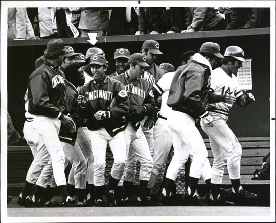 APRIL 7, 1975: Exit The Victors, Rejoicing: Pete Rose leads the way as the Reds head for the lockers after George Foster (arrow) legged out a hit that won the opener, 2-1. Identifiable are Pat Darcy, Joe Morgan, Ken Griffey, Doug Flynn, Jack Billingham, Tony Perez, Terry Crowley, John Vukovich.