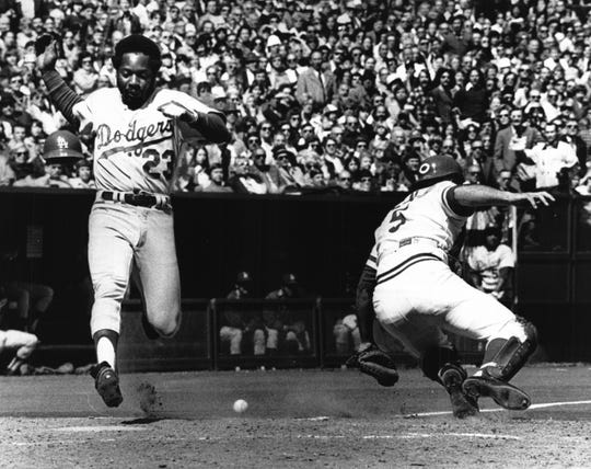 APRIL 7, 1975: Scoring For A Brief Dodger Lead...Cincinnati native Jim Wynn crossed plate for Dodgers' only run in fourth inning on Steve Garvey's single to right field.