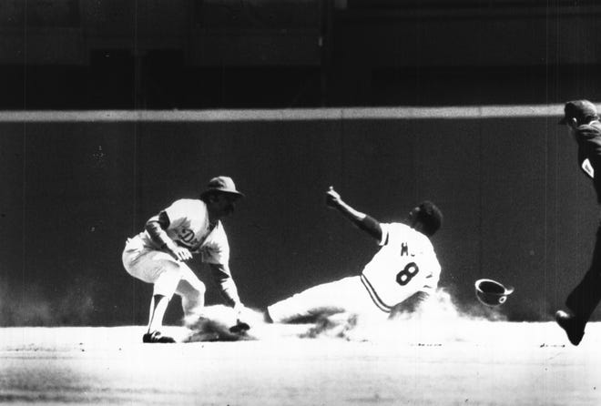 APRIL 7, 1975: Reds' Joe Morgan Steals First Base Of Year...Dodgers' Davey Lopes was too late with tag in first-inning play during Reds' opener Monday. Cincinnati won, 2-1, in 14 innings.