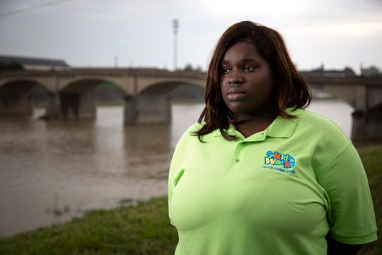 Courtney Jackson, 26, poses in front of the Black Street Bridge in Hamilton, Ohio, on Wednesday, May 22, 2019. Jackson was driving home from work on May 2 when she heard a man screaming on the bridge. She turned around and stopped to ask if the man was OK. He was sitting on the ledge, still screaming. She asked if he wanted to get a cup of coffee and he agreed. She gave him a jacket and the McDonaldÕs breakfast sandwich she had just ordered for herself. The police were called, and the man was taken to the hospital. Jackson doesnÕt know what happened to him.