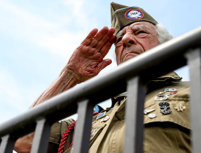 Vincent Speranza salutes a passing division while early 15,000 soldiers from the 101st Airborne Division gathered with their units for a review following the Week of the Eagles at Parade Field in Fort Campbell, KY., on Thursday, May 23, 2019.