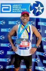 Joyjit Kundu with his Boston Marathon and Abbott World Marathon Majors 6 star medals.