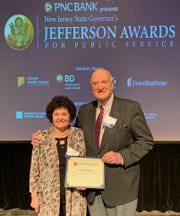 The Scotch Plain-based music therapy program received a $20,000 National Endowment for the Arts grant to support Music For Hope and Healing, a program for children and families living in shelters. Pictured are Artistic Director Rena Fruchter and Executive Director Brian Dallow receiving a New Jersey Governor's Jefferson Award for Public Service for their cathartic Voices of Valor songwriting program for veterans.