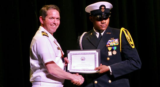 Linden High School NJROTC Male Cadet of the Year Maurice Faulk, with Commander Boyd Decker, U.S. Navy retired, who is senior Naval Science instructor at LHS.