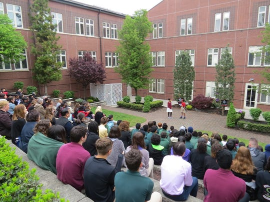 Eighth graders perform A Midsummer Night's Dreambefore a packed amphitheater.