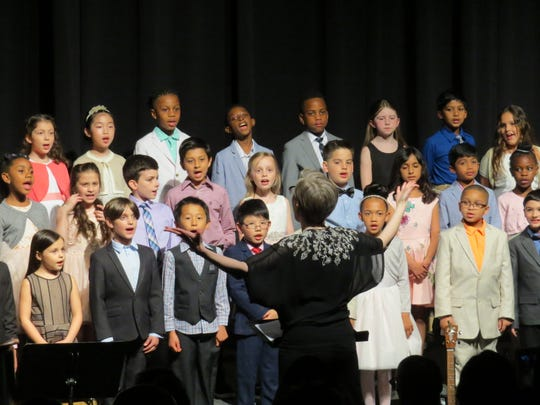 Second and third graders sing at the Lower School concert.